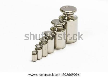 calibration weight set  isolated on white background  - stock photo