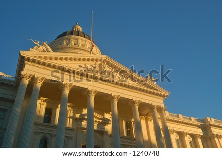 California Capitol building in Sacramento illuminated by the evening sun - stock photo
