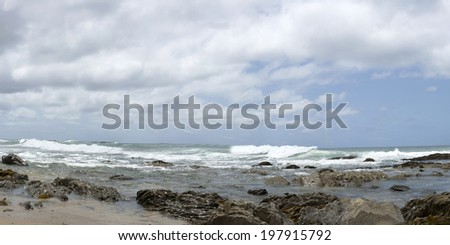California coast a stretch of sandy beach beautiful blue cloudy sky - stock photo