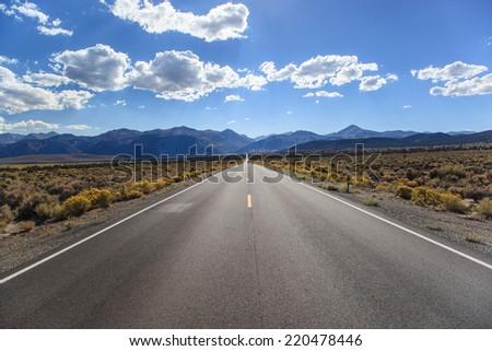 California highway 167 facing Sierra Nevada mountains - stock photo