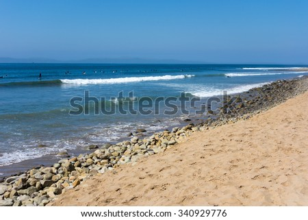 California surfers catching waves between Ventura City Beach and distant Channels Islands - stock photo