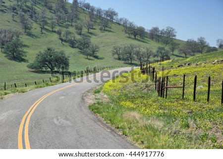 California, United States - winding road in countryside landscape of Tulare County. - stock photo