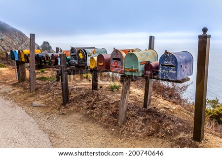 CALIFORNIA - USA - OCT 13, 2013: grunge mailboxes along Pacific Highway Route 1 US seen on OCT 13, 2013, California, USA. - stock photo