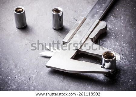 Caliper measuring metal parts. - stock photo