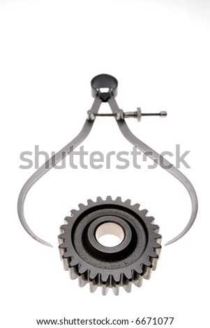 Calipers and cogwheel - stock photo