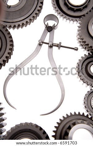 Calipers and cogwheels over white - stock photo