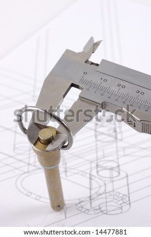 Calipers and pip-pin on a technical drawing - stock photo
