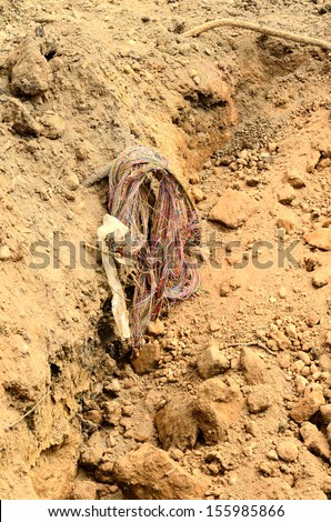 Call before you dig, phone lines exposed by a excavator at a construction poject trench - stock photo