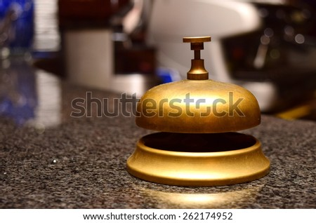 call bell made of bronze at a hotel front desk  - stock photo