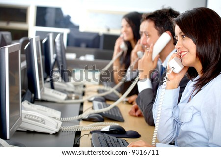call center business team in an office full of computers - stock photo