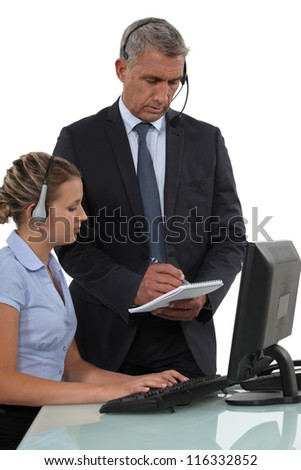 Call-center employee with boss - stock photo