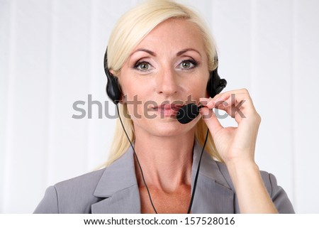 Call center operator in office - stock photo