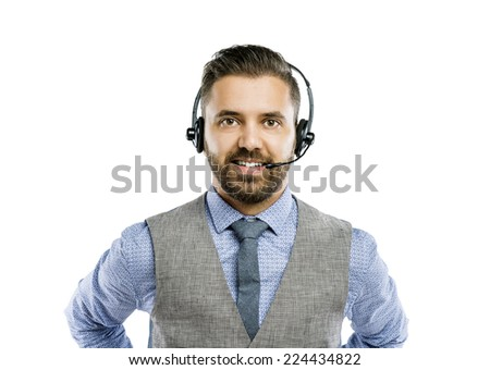 Call center operator isolated on white. Young handsome hipster man with headset. - stock photo