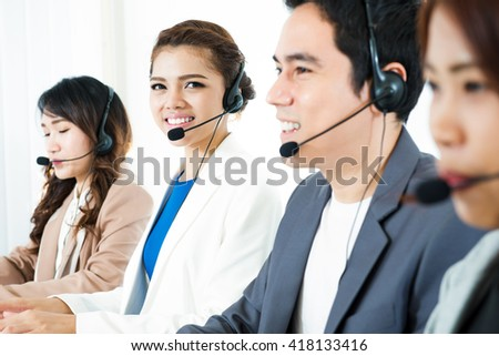 Call center (operator or telemarketer) team - telemarketing and customer service concept - stock photo