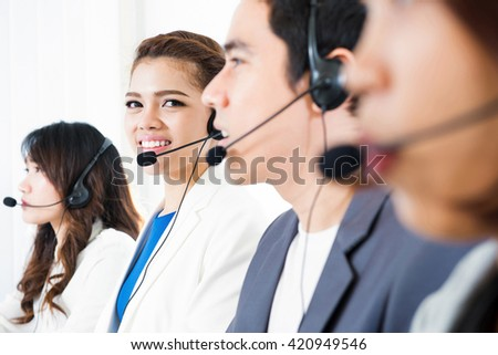 Call center (operator or telemarketer) team - telemarketing and customer service concepts - stock photo