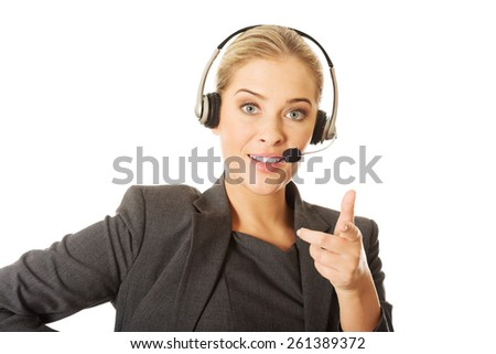 Call center woman talking to customer. - stock photo