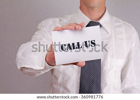 Call, contact Us. Close up of businessman showing card.  Business and finance. Copy space image. - stock photo