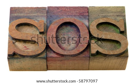 call for help - SOS word in vintage wooden letterpress printing blocks, isolated on white - stock photo