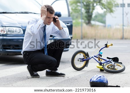 Calling for help after car accident, horizontal - stock photo