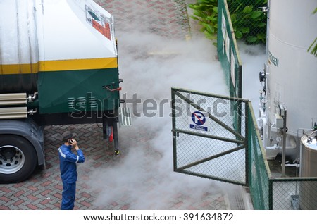 Calling for help to repair leaking pipes of Oxygen tank - stock photo