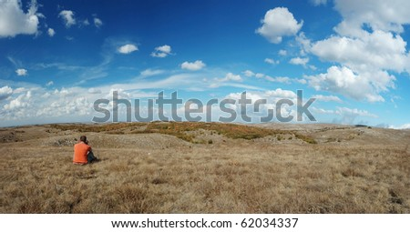 Calling home from the top of the mountain - stock photo