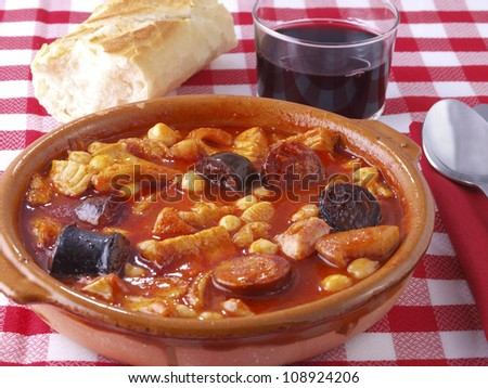 Callos a la Madrile�±a. â��Callosâ� is a typical  dish from Madrid. The main ingredient is beef tripe, cooked with red spicy sausage (chorizo), black sausage (morcilla), ham, and sometimes chickpeas. - stock photo