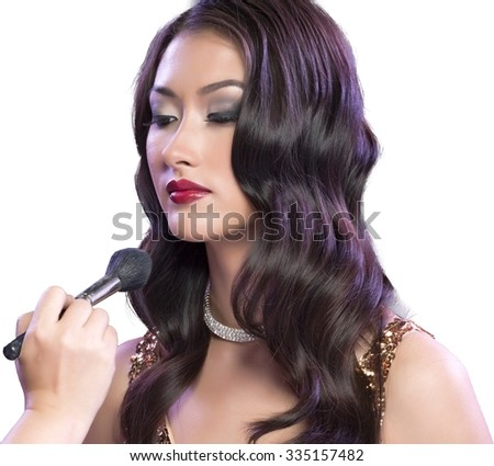 Calm Asian young woman with long medium brown hair in evening outfit using paintbrush - Isolated