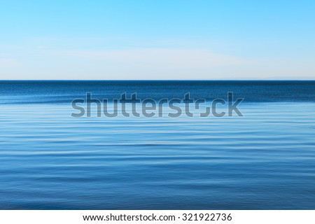 Calm Baltic sea and clear blue sky. - stock photo