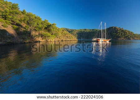 Calm bay with clear water and anchored sail boats. Turkey - stock photo