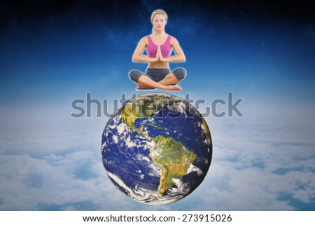 Calm blonde sitting in lotus pose with hands together against white clouds under blue sky - stock photo