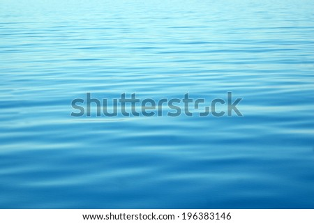 calm blue water, Abel Tasman National Park, New Zealand - stock photo