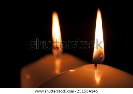 calm, bright, can be romantic or festive light candles on a black background. The light in the darkness.