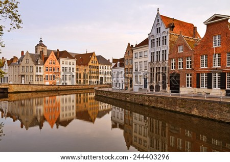 Calm canal streets at sunset in Bruges, Belgium. - stock photo