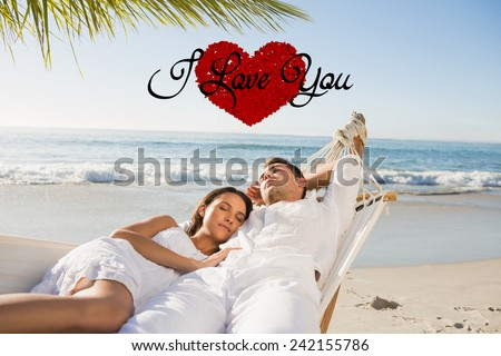 Calm couple napping in a hammock against i love you - stock photo