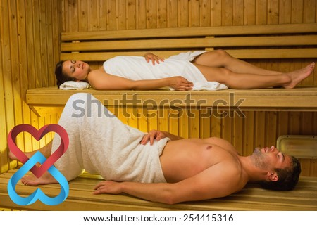 Calm couple relaxing in a sauna against linking hearts - stock photo