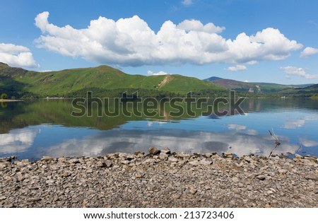 Calm day Derwent Water Lake District National Park Cumbria England uk near Keswick with reflections on still water and Catbells mountains  - stock photo