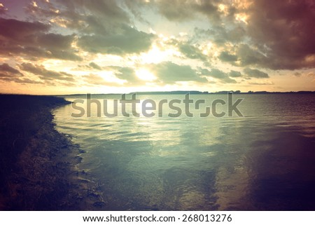 Calm lagoon retro colors landscape at sunset. Chill out concept photography. - stock photo