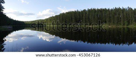 Calm lake reflection in sunset - stock photo