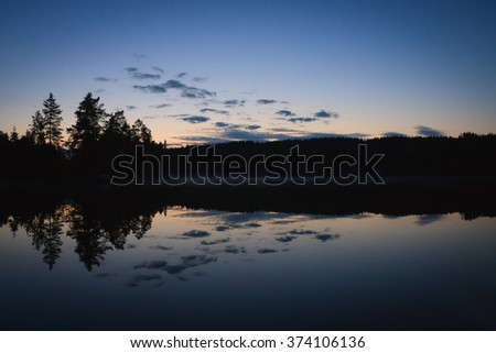Calm lake scape at summer night - stock photo
