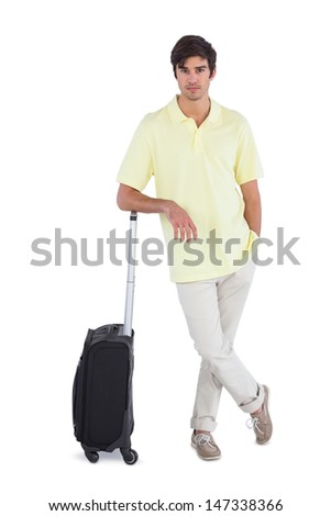 Calm man standing with his suitcase on a white background