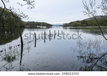 Calm moody evening landscape over Coniston Water in Lake District - stock photo