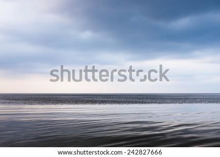 Calm sea and blue clear sky. - stock photo