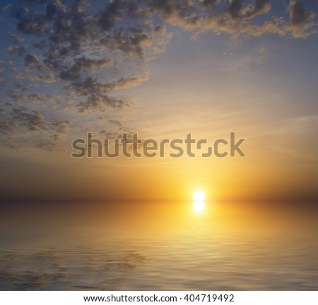 Calm sea on the background of a beautiful sunset is unreal and reflection in small waves. Natural landscape composition - stock photo