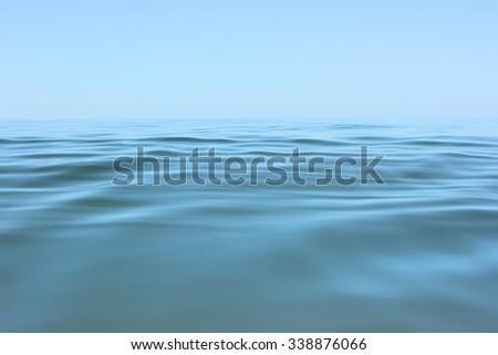 Calm sea surface. Seascape in early morning hours under clear skies. - stock photo