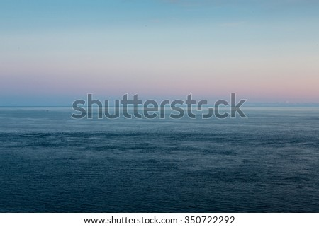 Calm sea with colorful sky, Pointe du Raz, Normandy, France