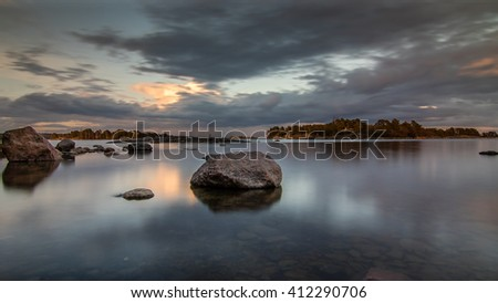 Calm seascape with rocks in water - stock photo