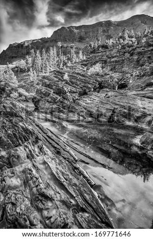 Calm stream on Redrock Trail in east Glacier National Park, Montana - stock photo