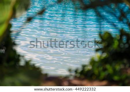 Calm waters through Trees at Hamilton Island, Australia - stock photo