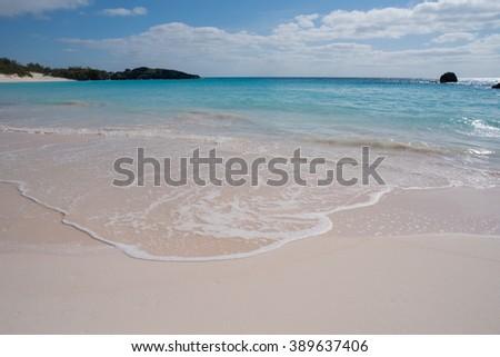 Calm waves on a tropical beach - stock photo