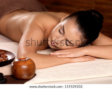 Calm woman after massage relaxing in spa salon. Beauty treatment concept. - stock photo